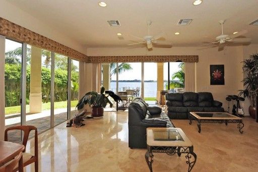 Direct Intracoastal Waterfront Property with Private Beach in Palm Beach under $1.5M